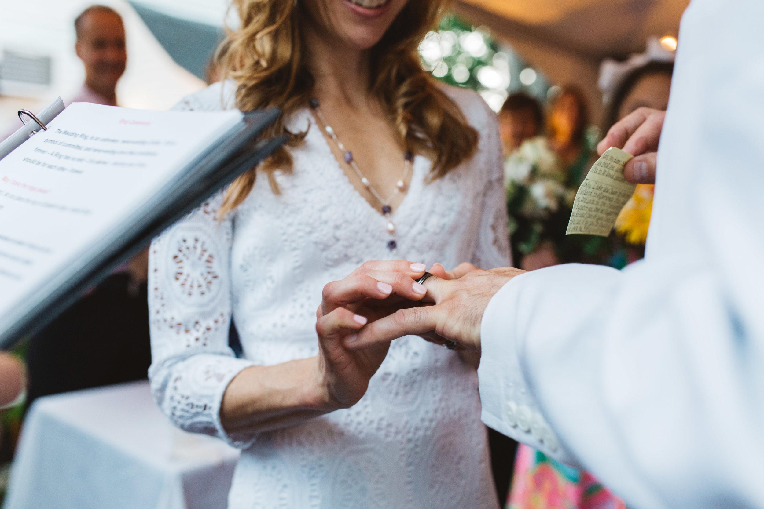 Exchanging wedding bands - Elizabeth and Sean's intimate Attleboro wedding ceremony