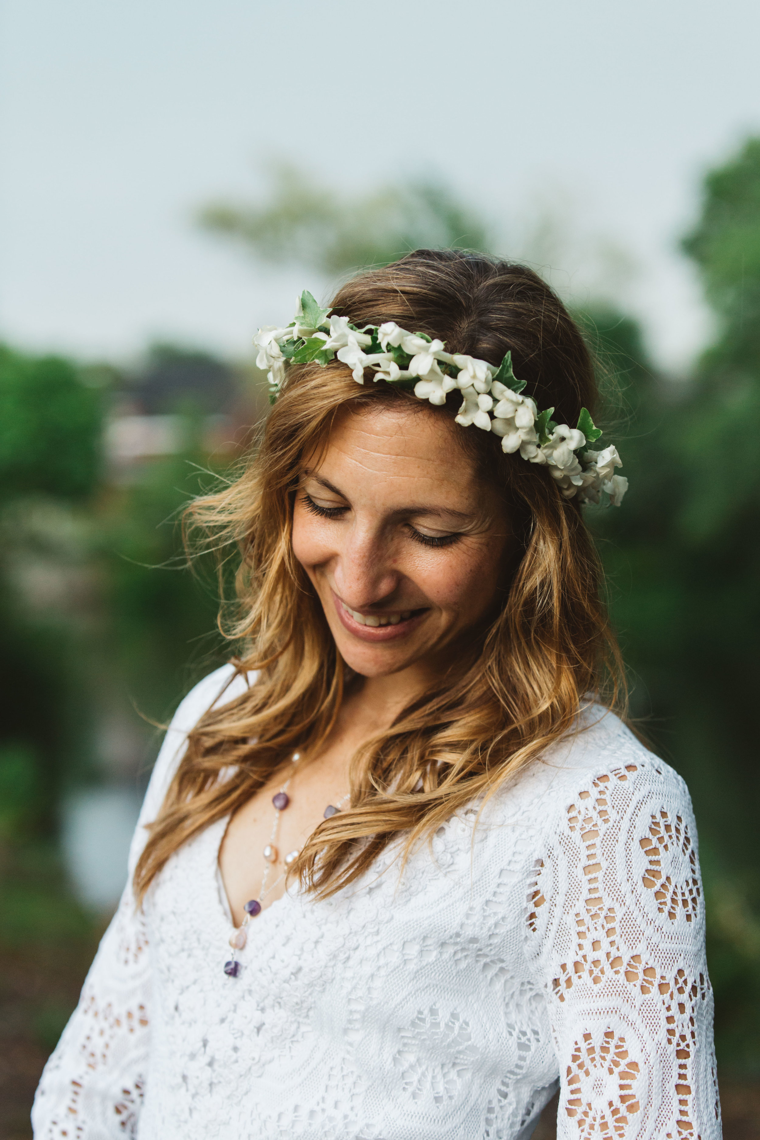 A portrait of Elizabeth and her drool-worthy floral crown - Elizabeth & Sean's intimate Attleboro wedding