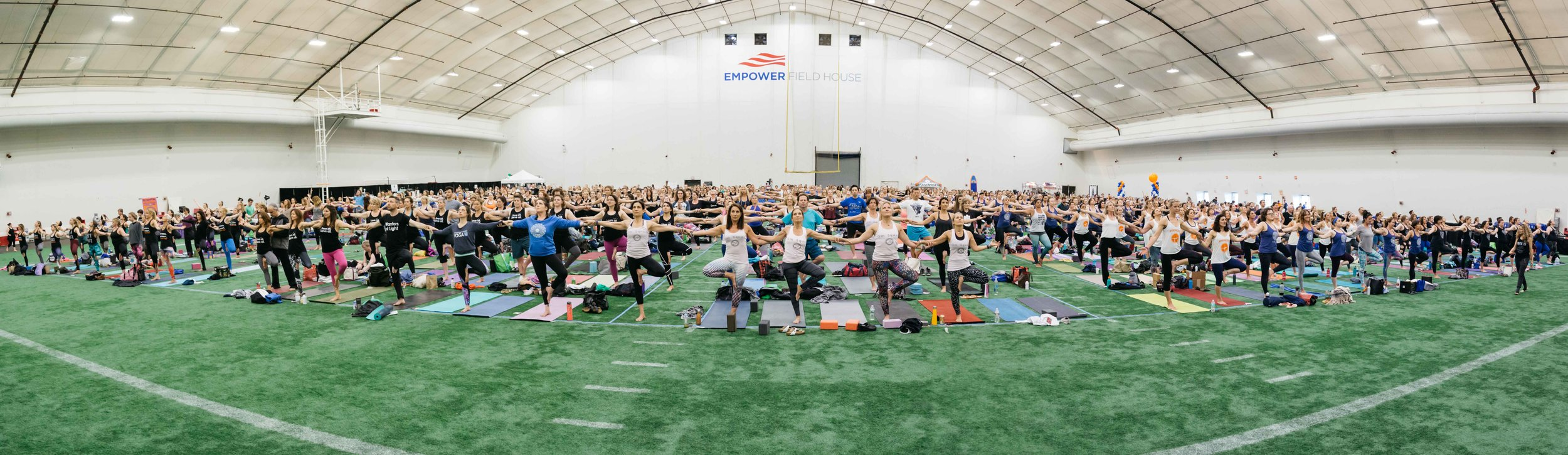 Over 900 yogis linked arm in arm to support Boston Children's Hospital Wellness Center.