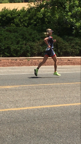 Kelly Emich cruising down the race course at St. George 70.3.