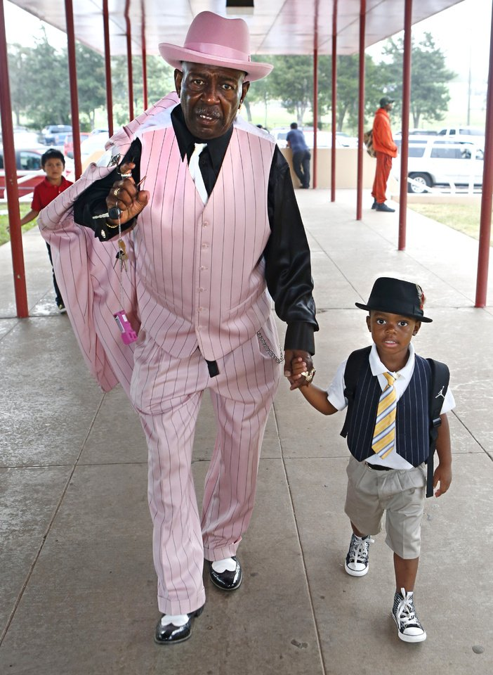 Arthur Washington walks with his step-grandson, kindergartner Jordan Franklin, on Friday. It was Take Your Child to School Day at F.D. Moon Elementary School. Photo by David McDaniel, The Oklahoman
