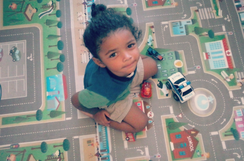 My 2 year old son playing on the City/Farm playMAt.