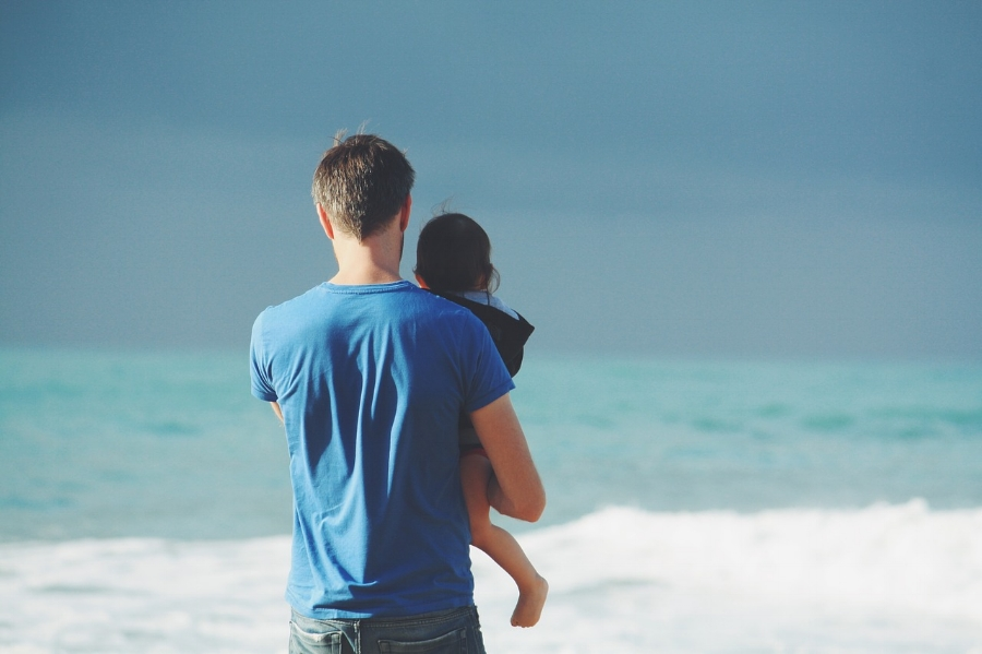 Dad at the beach with child