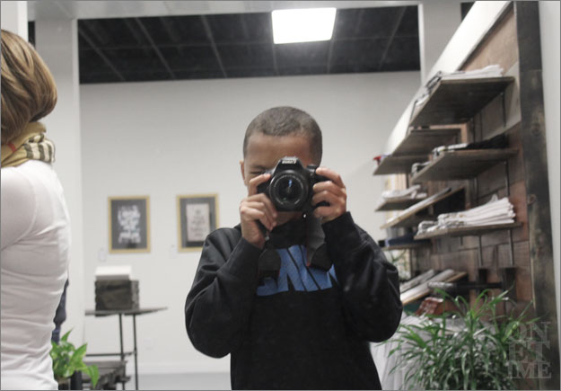 """Our """"little photographer"""" for the evening. (He also somehow made a living being the cashier, dj, bouncer, waiter, and deckhands.)"""