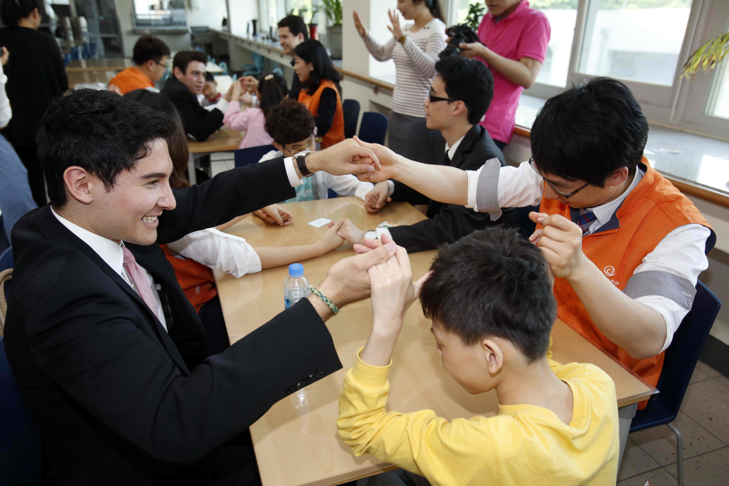 The Alley Cats interact with the students at the Seoul School for the Blind