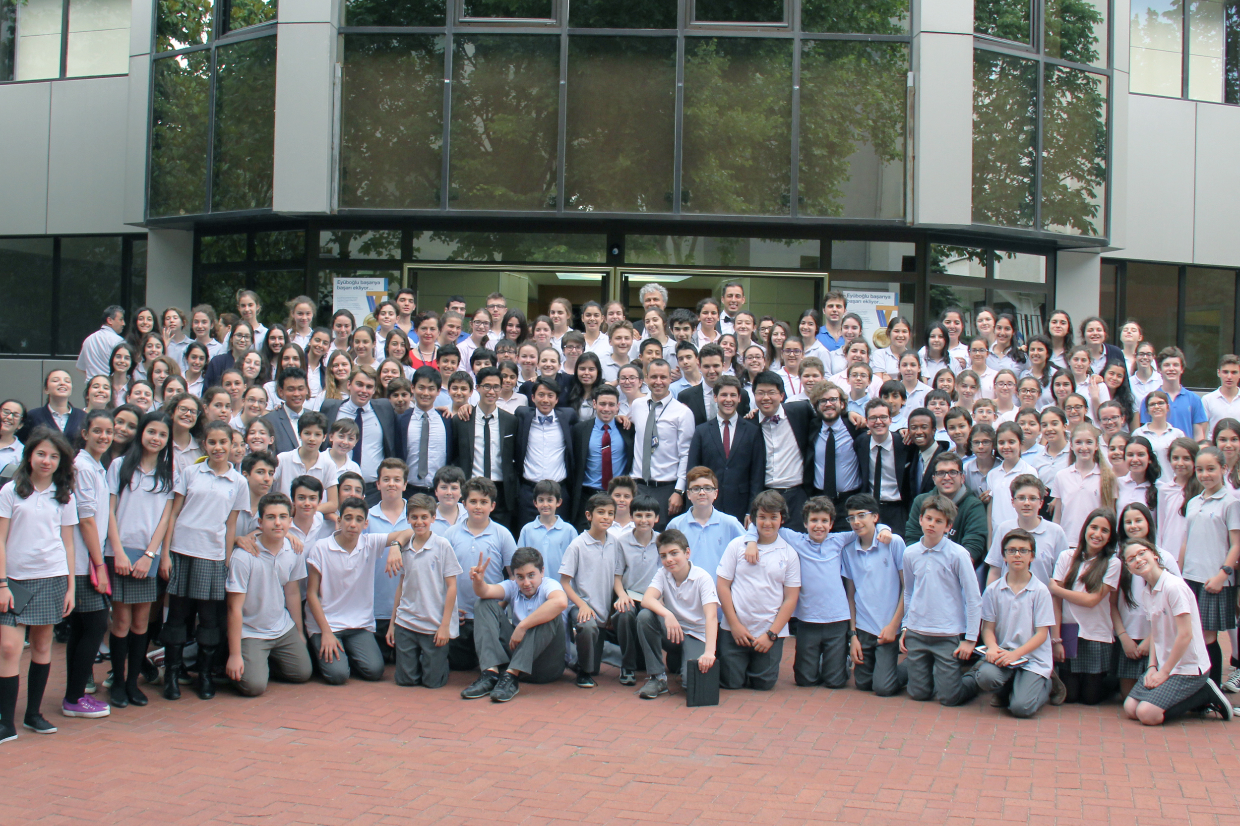 The Cats take a group shot with Eyuboglu High School in Istanbul, Turkey