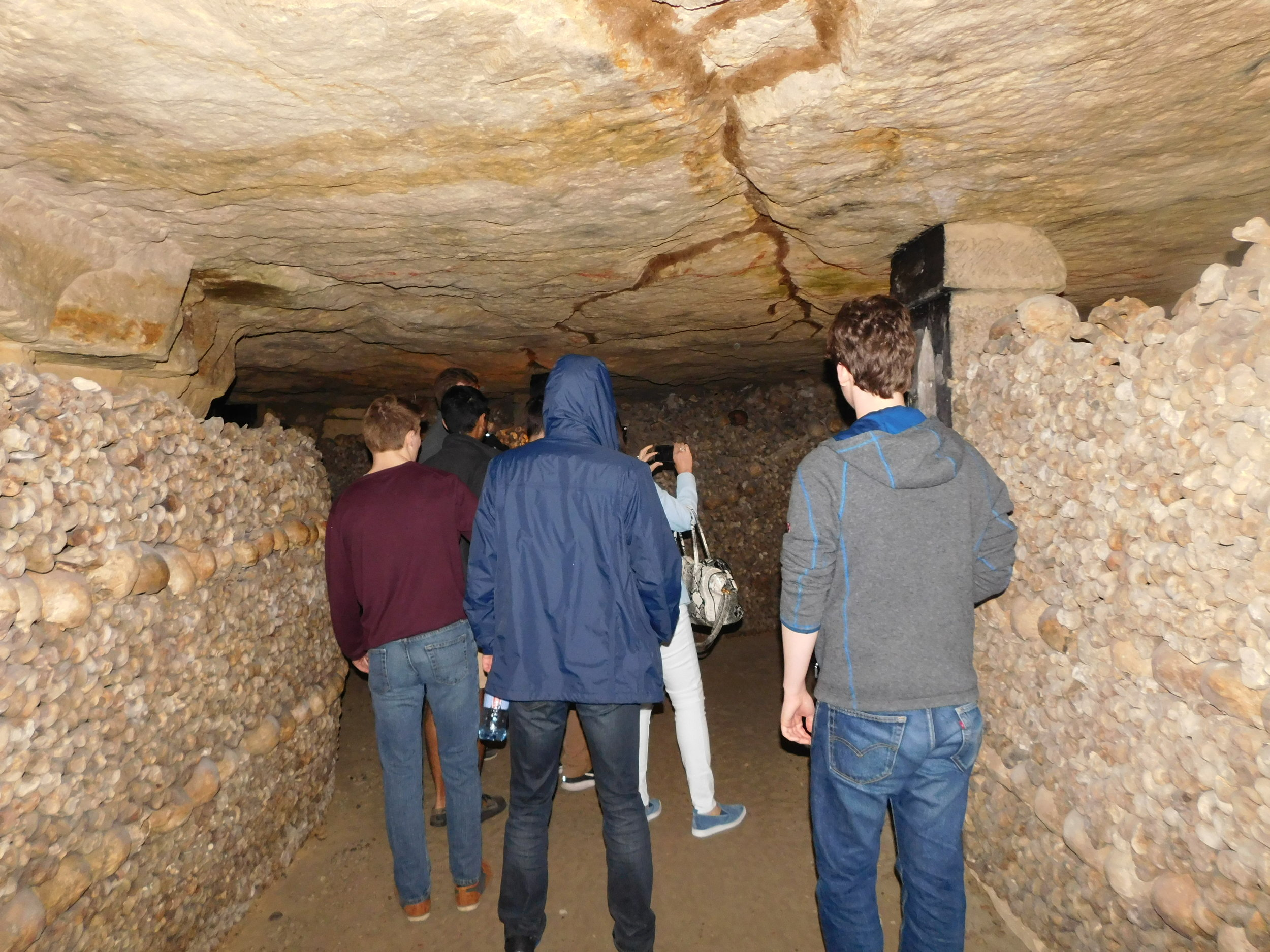 Visiting the Catacombs under the city of Paris