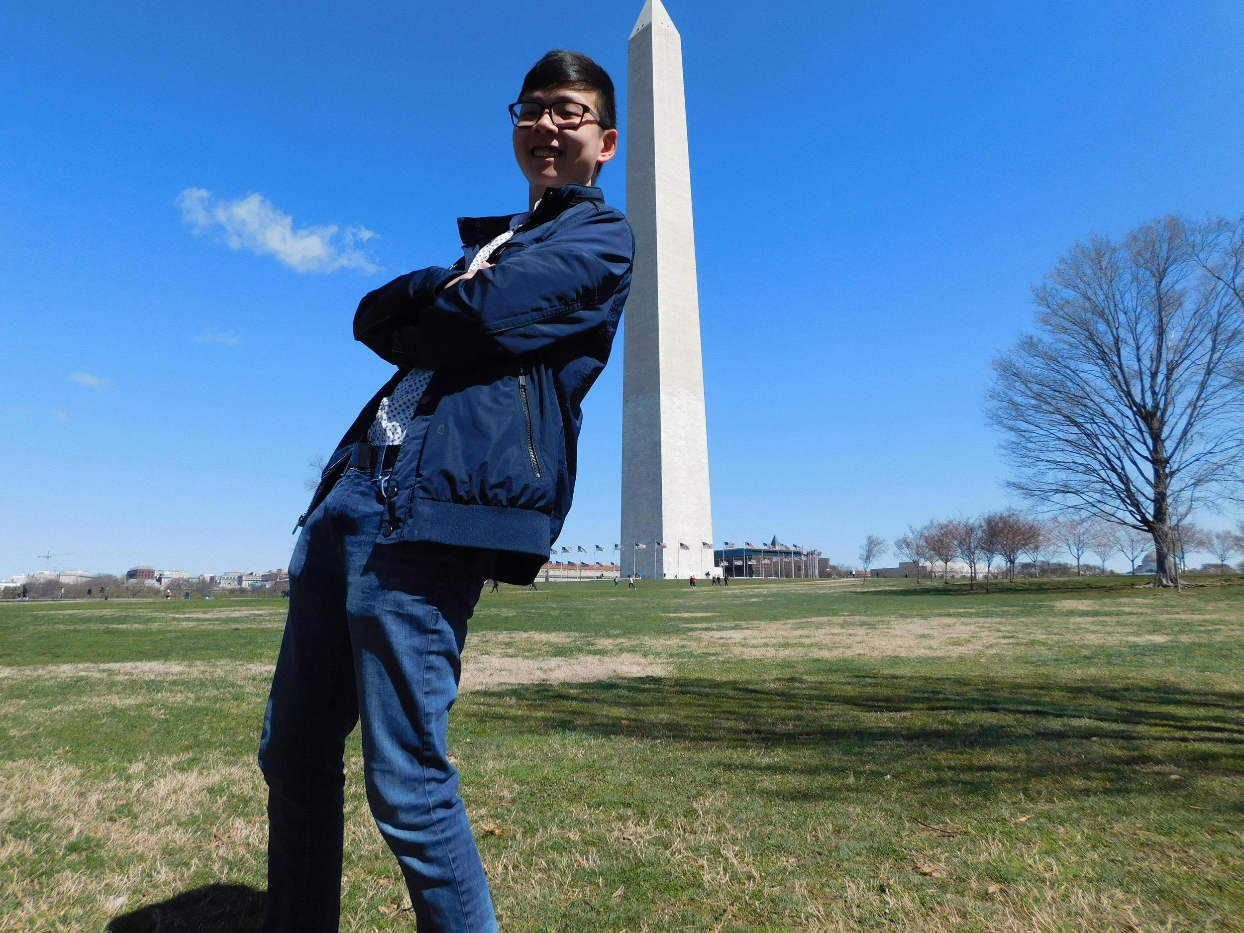Dustin taking a Tourist photo with the Washington Monument