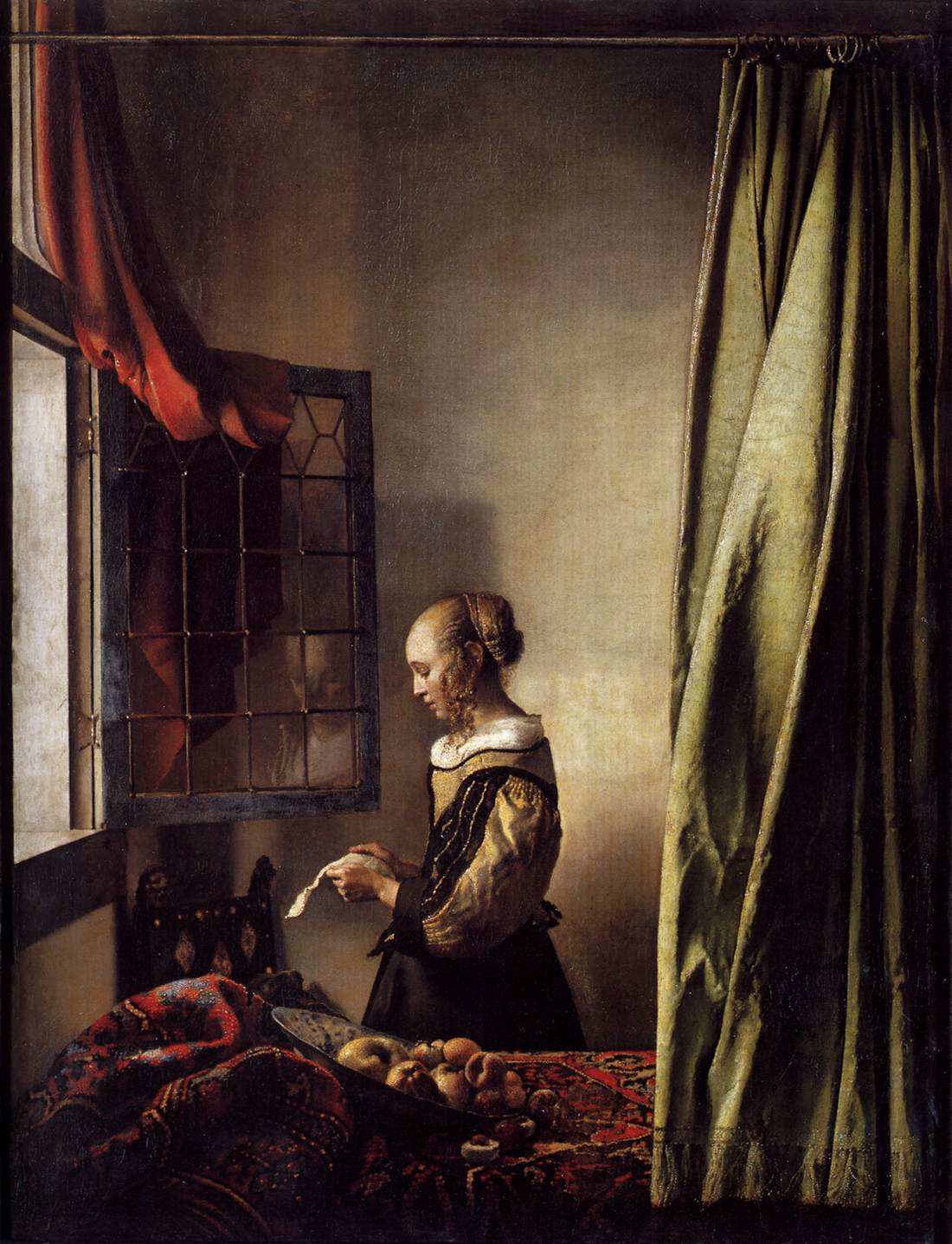 girl-reading-a-letter-at-an-open-window.jpg