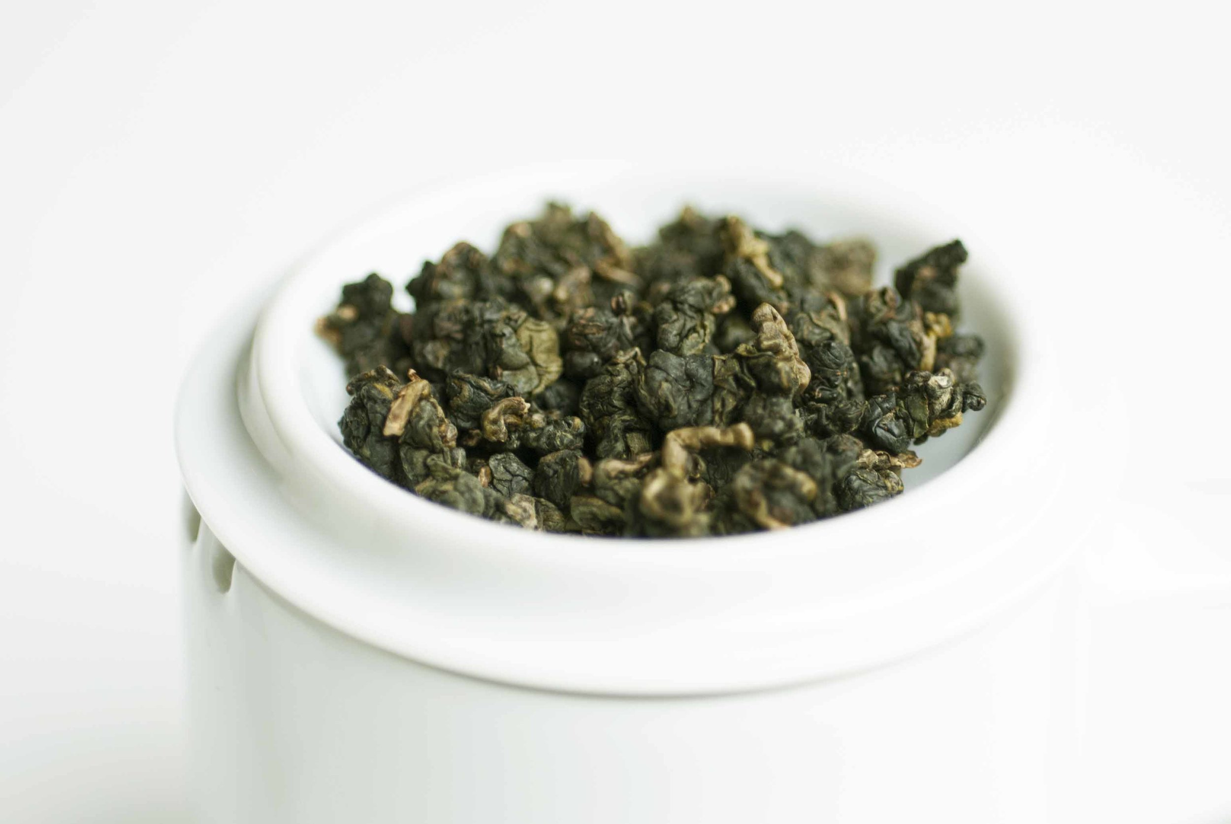 Fresh Qingjin High Mountain Oolong with scents of fresh flowers and forest.