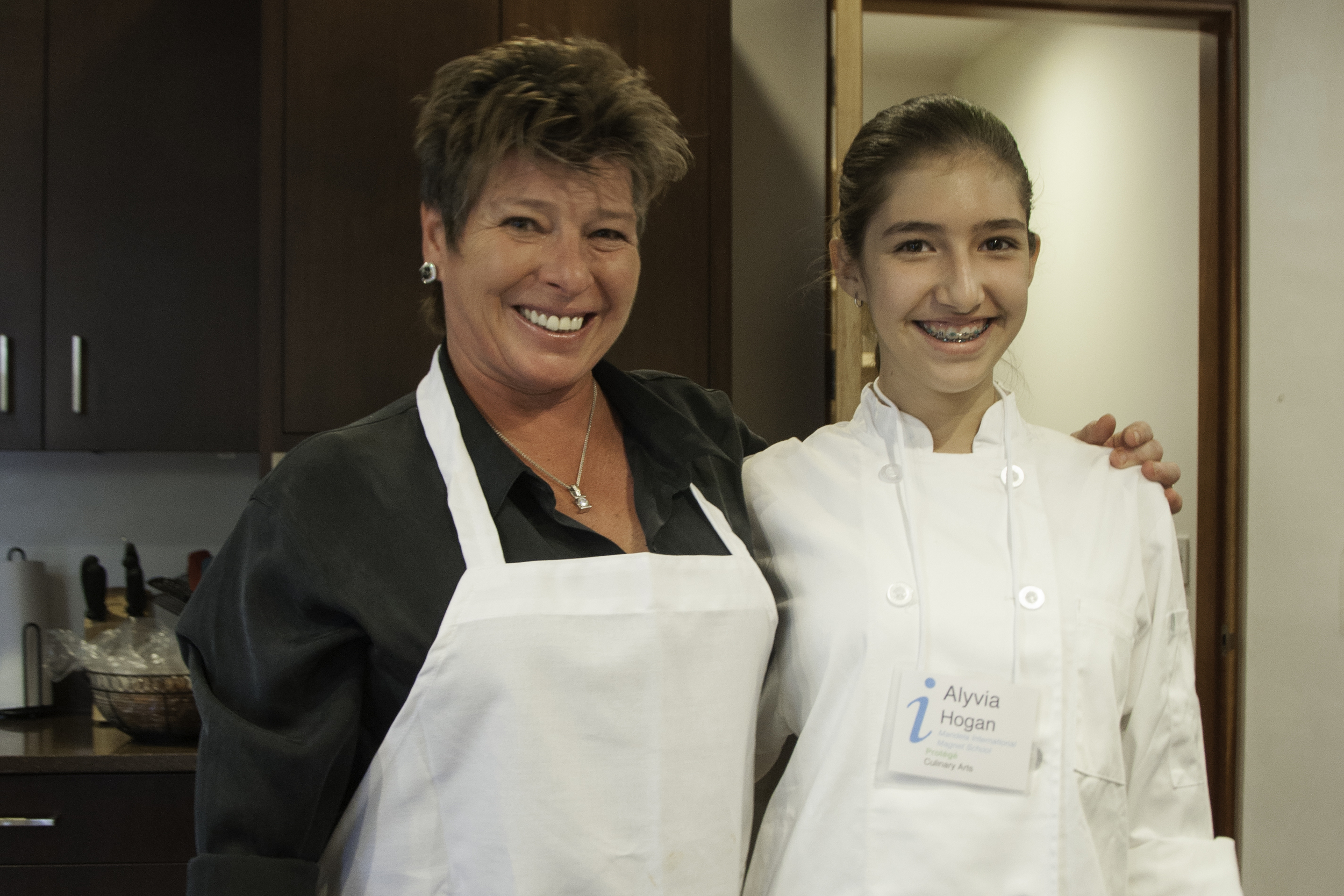Catherine O'Brien -  Catherine O'Brien received her formal chef's training and earned her Culinary Degree with high honors from Johnson and Wales University in Rhode Island. Some of Catherine's 25 years of experience include Executive Chef of the University Club in Baltimore, Maryland, Chef Garde Manger at the Hyatt Regency Grand Cypress in Orlando, Florida and Corporate Catering Chef for the Smithsonian Institution in Washington, D.C.     Alyvia Hogan - Alyvia is a seventh grader at Mandela International Magnet School.