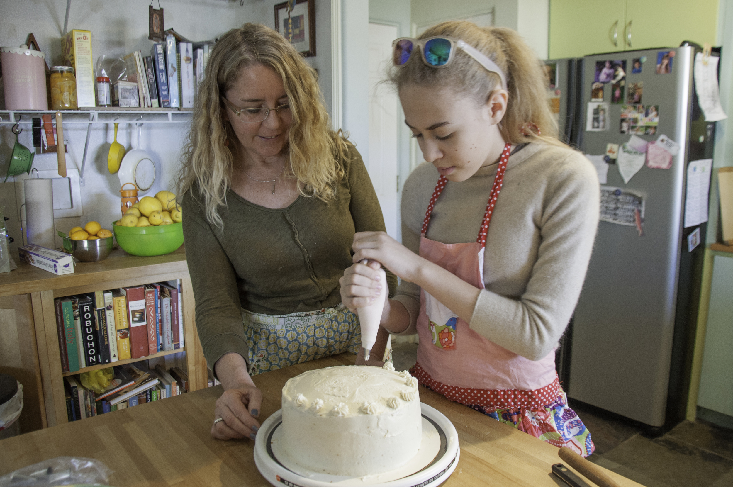 """Jane Pric  e - Jane Price enjoys being a longtime resident of Santa Fe. She is a dedicated Postpartum Doula, caring for babies through her business, Mothering Mothers. Another passion is her business, Tea Rose Baking. """"Homemade desserts"""" for holidays and all occasions are her speciality. """"I love nurturing, and baking is another creative way to express it. Baking a cake, with organic local ingredients, and sharing my knowledge of the kitchen, including through mentoring, just as my mother did for me, passes on a deeply satisfying generational gift.""""   Honoree Gaugy - Honoree Gaugy is an eighth grader at Mandela International Magnet School."""
