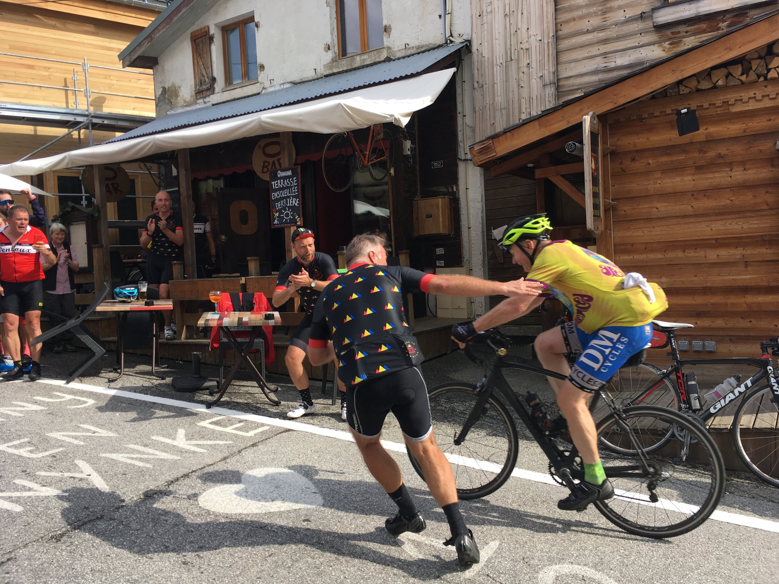 Cheering our riders in as they arrive on Alpe d'Huez