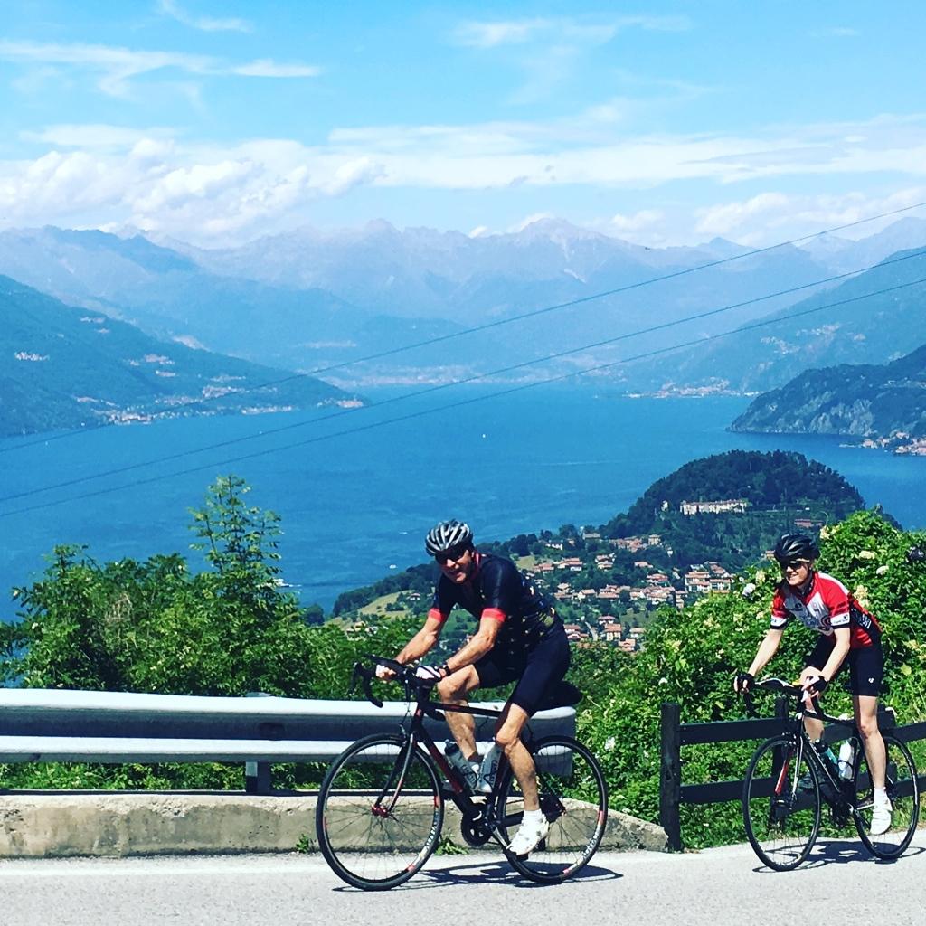 Climbing to the Madonna del Ghisallo cycle chapel, with Lago di Como as a backdrop