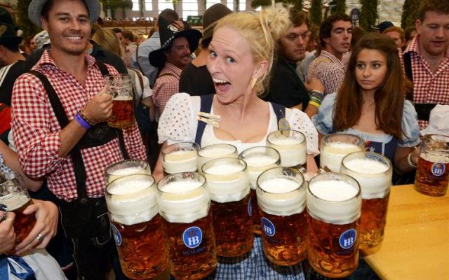 German girl serving beers Oktoberfest