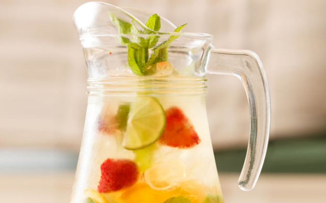 Jug of gin with fruit