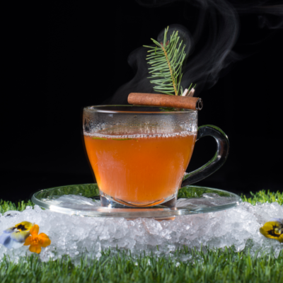 Glendalough gin hot toddy cocktail with cinnamon stick