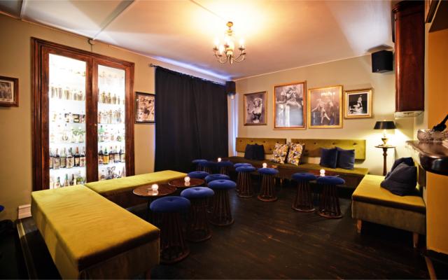 Curfew Copenhagen bar stylish blue stools and green sofas