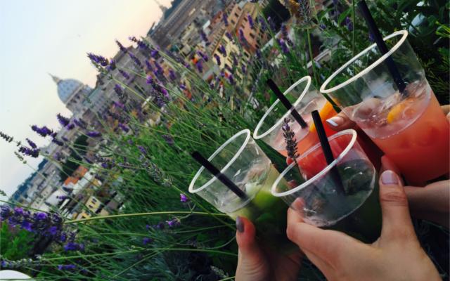 Aperitivo drinks on rooftop over looking skyline