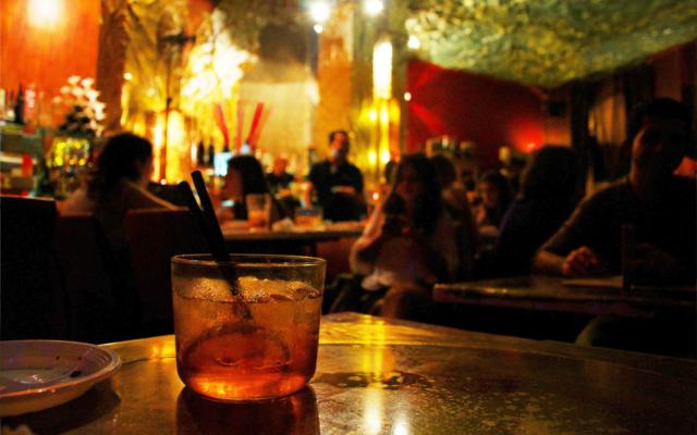 Negroni drink in backlit bar