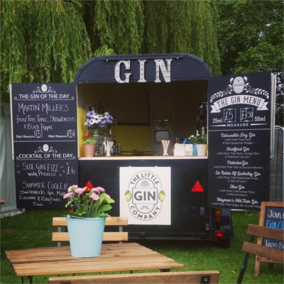 Mobile Gin Bar trailer in garden serving gin and tonics and cocktails