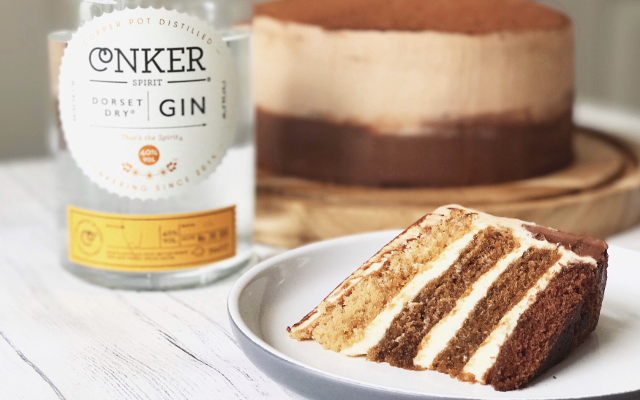 slice of Conker gin cappuccino cake and conker gin bottle