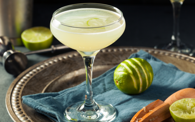Gin Gimlet cocktail with lime in a coupe glass