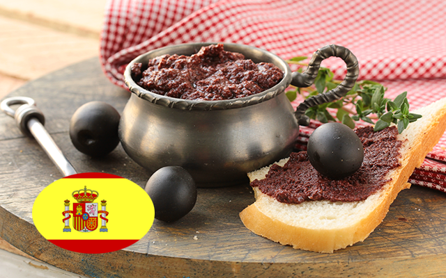 Black Olive Tapenade in a bowl witholives