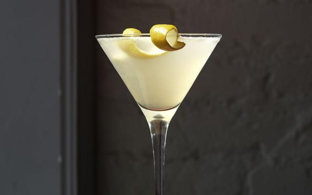 Gin+Sour+white+cocktail+with+lemon+zest+twist+garnish.png