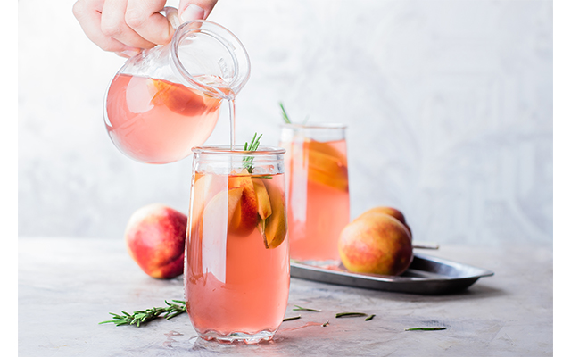 Pink gin and peach lemonade is a delightful summer cocktail