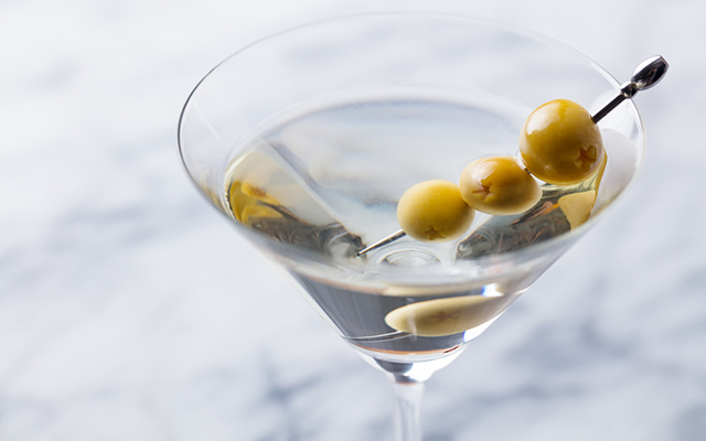 A classic Martini with an olive garnish.