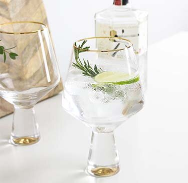 two-gold-gin-glasses.png