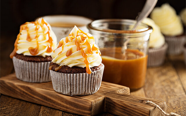 Gingerbread cupcakes with toffee gin icing and salted caramel! Get the recipe >>