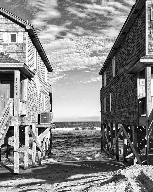 Oceanfront houses in Rodanthe, NC. #uponsand • • • • • #subjectivelyobjective #anotherplace #documentingspace #bnwsouls #sombrebw #aintbad #bnw_drama #bnw_demand #awesomebnw #noir_shots #bnw_greatshots #bnw_creatives #bnw_capture #tv_hiddenbeauty #remnantmagazine #landscape_lover #landscape_captures #newtopographics #flakphotoplaces #archaicmag #paperjournalmag #rundownmagazine #noicemag #broadmag #newtopography