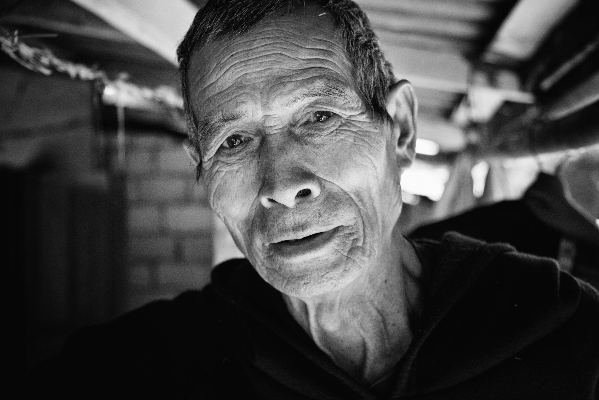Un Laotien désespéré de me voir partir de son pays.