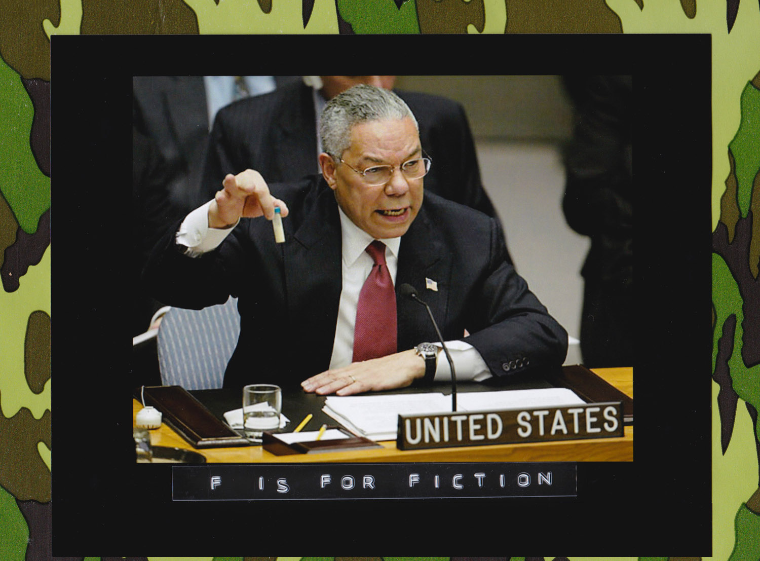 In his Feb. 5, 2003 address to the United Nations Security Council, U.S. Secretary of State Colin Powell holds up a vial he said could contain anthrax as he presents evidence of Iraq's alleged weapons programs. (Photo: Ray Stubblebine/Reuters)