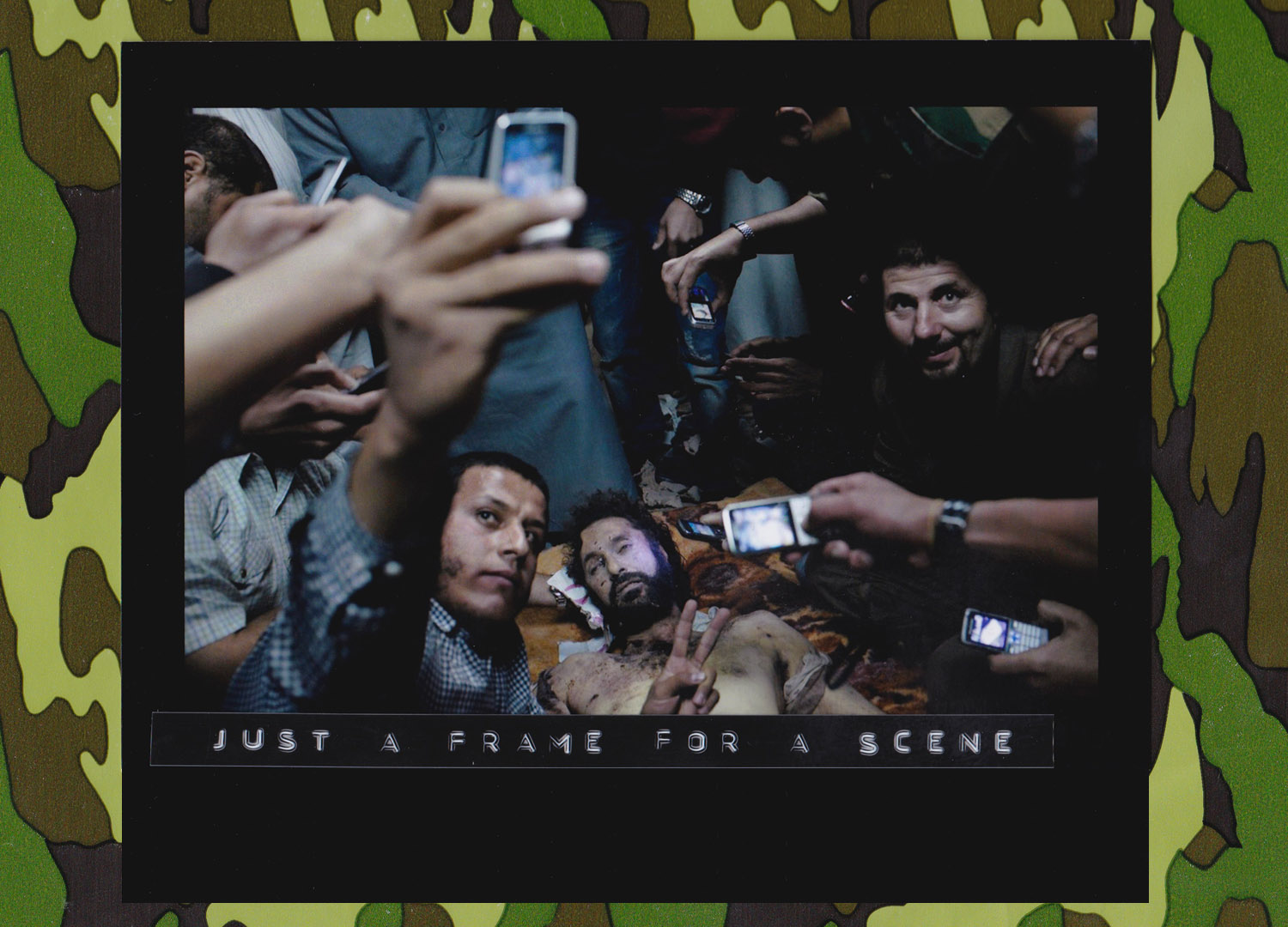 Libyans pose for pictures with the body of Muatassim el-Qaddafi, the son of Colonel Qaddafi, at a house in Misurata, Oct 19, 2011. (Photo: Mauricio Lima//The New York Times).