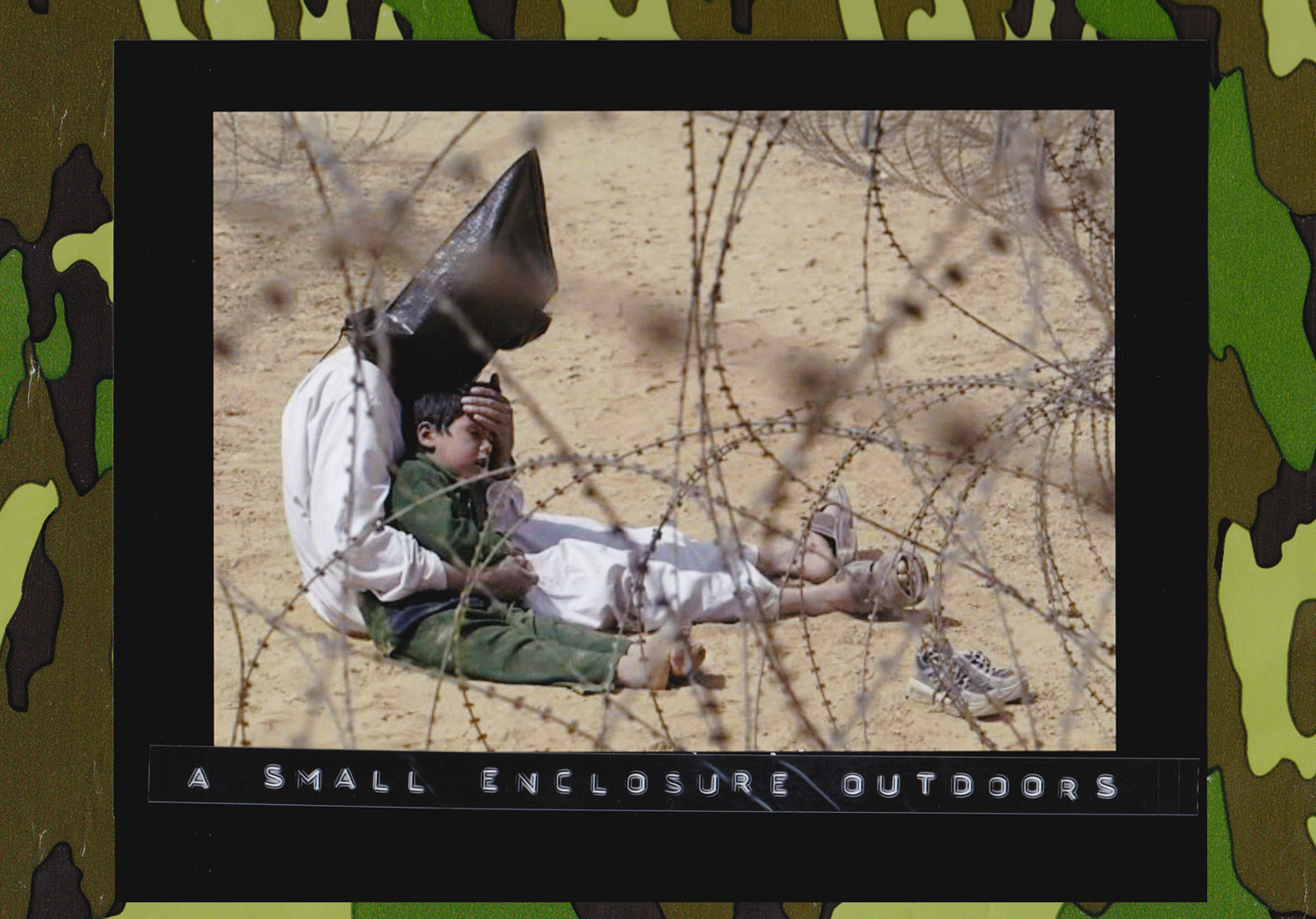 An Iraqi prisoner of war with his 4-year-old son at a regrouping center for POWs captured by the U.S. Army 101st Airborne Division near An Najaf, Iraq. March 31, 2003. (Photo: Jean-Marc Bouju/Associated Press)