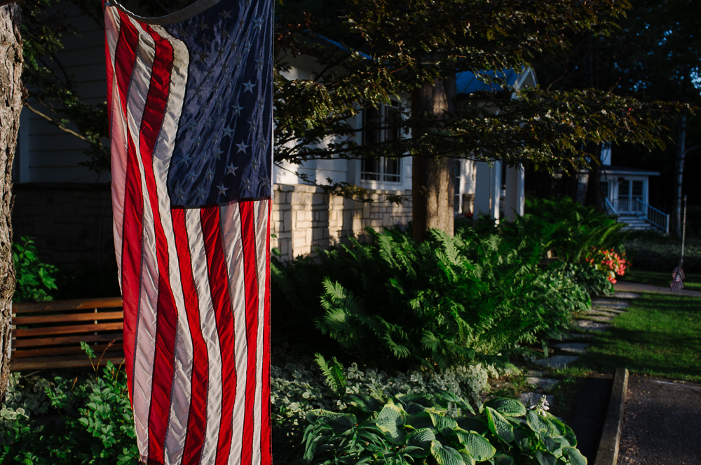 4th of July flag left hanging outside a house