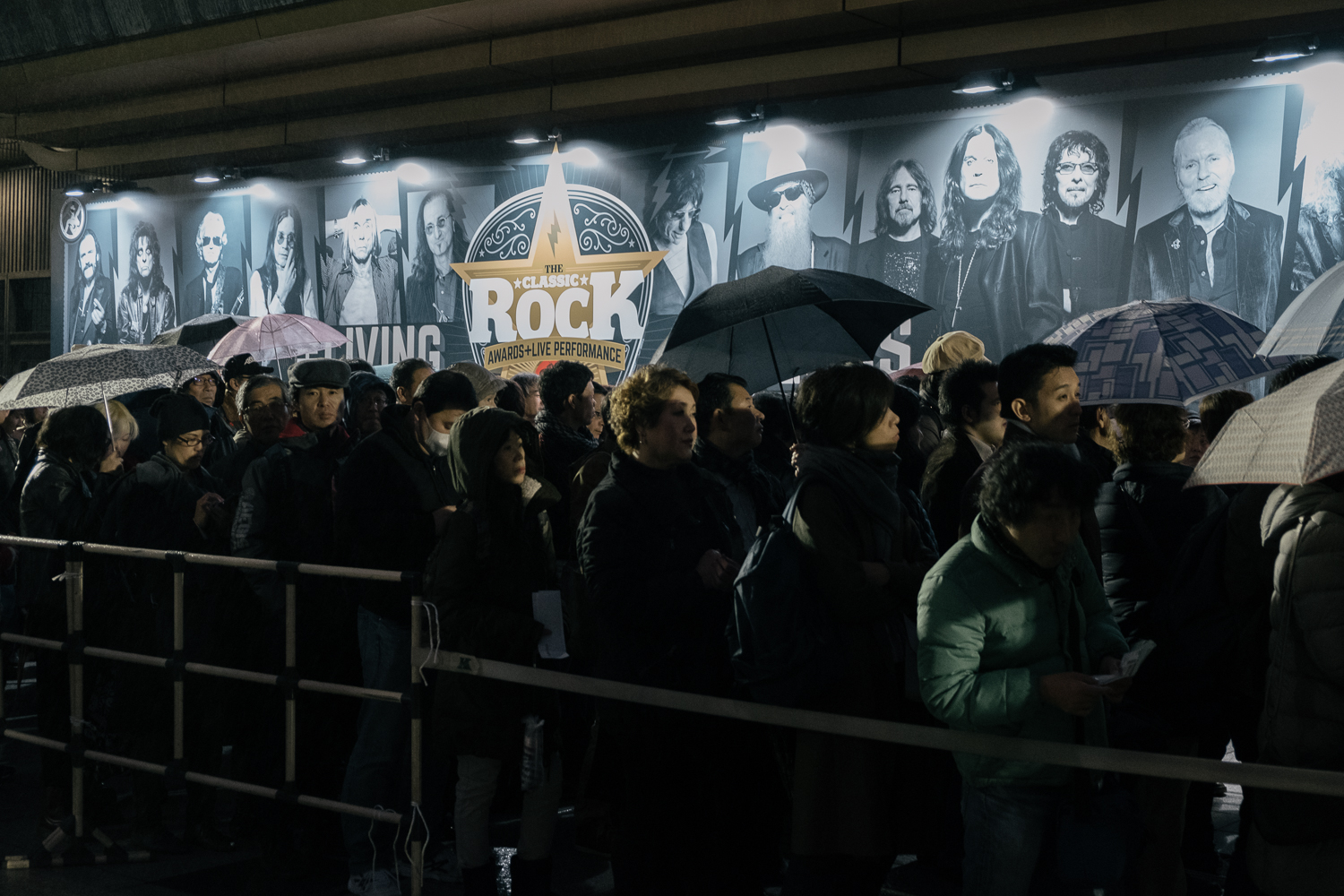 The crowd wait very patiently in the rain , Japan Classic Rock Awards