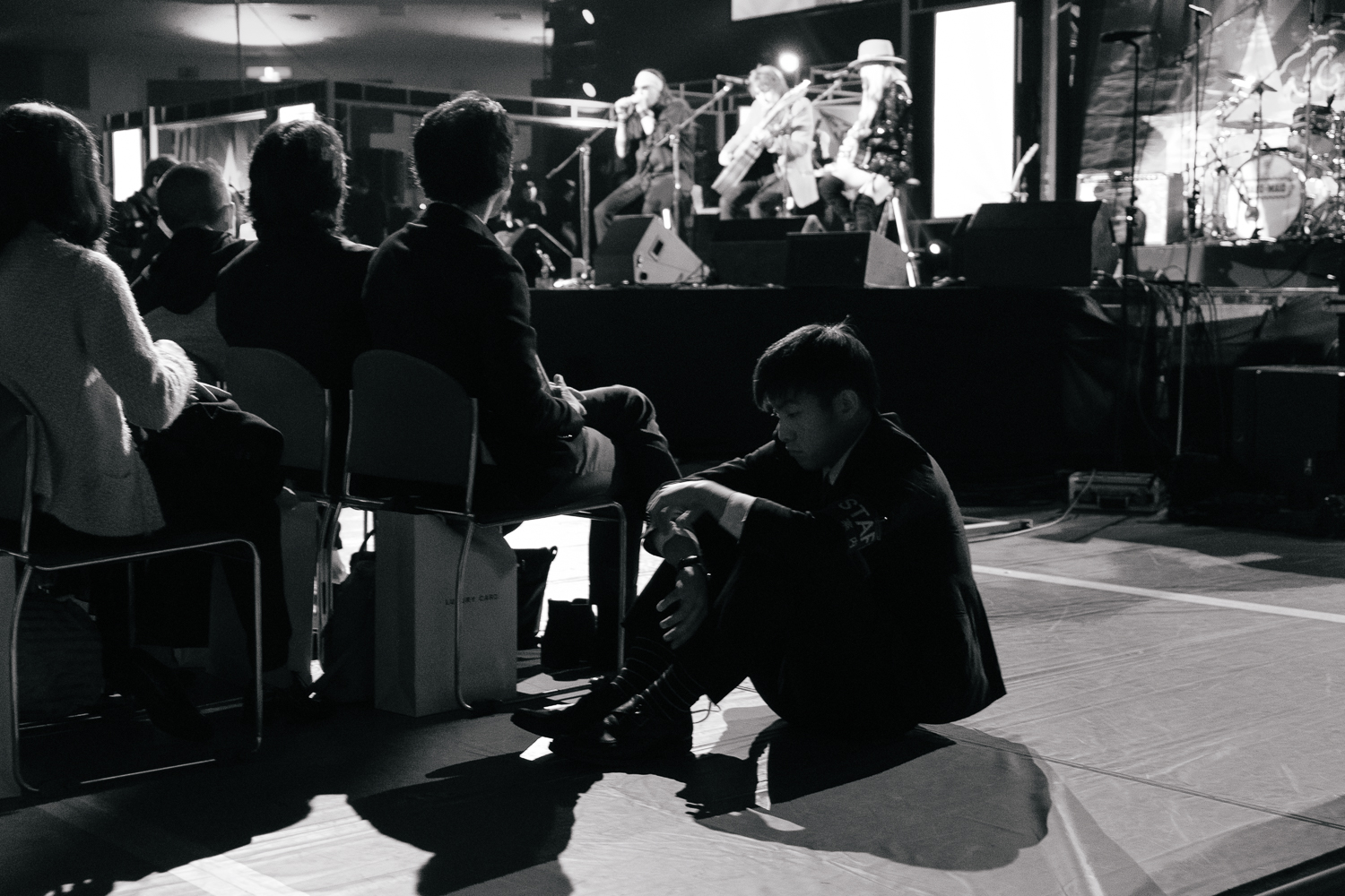 Stewards sit patiently on the floor , Japan Classic Rock Awards