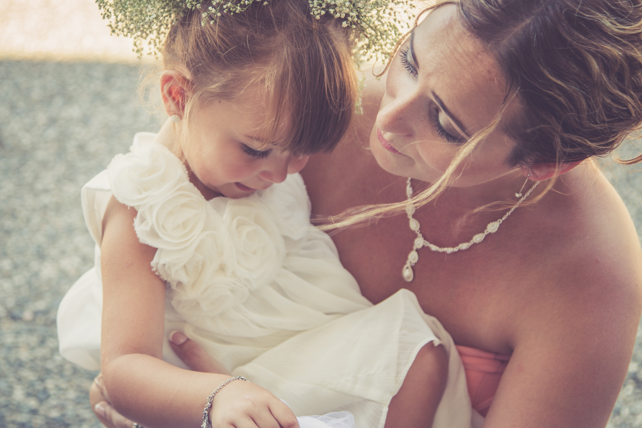 Bridesmaid and flower girl at Rockwater Secret cove elopement and wedding spot