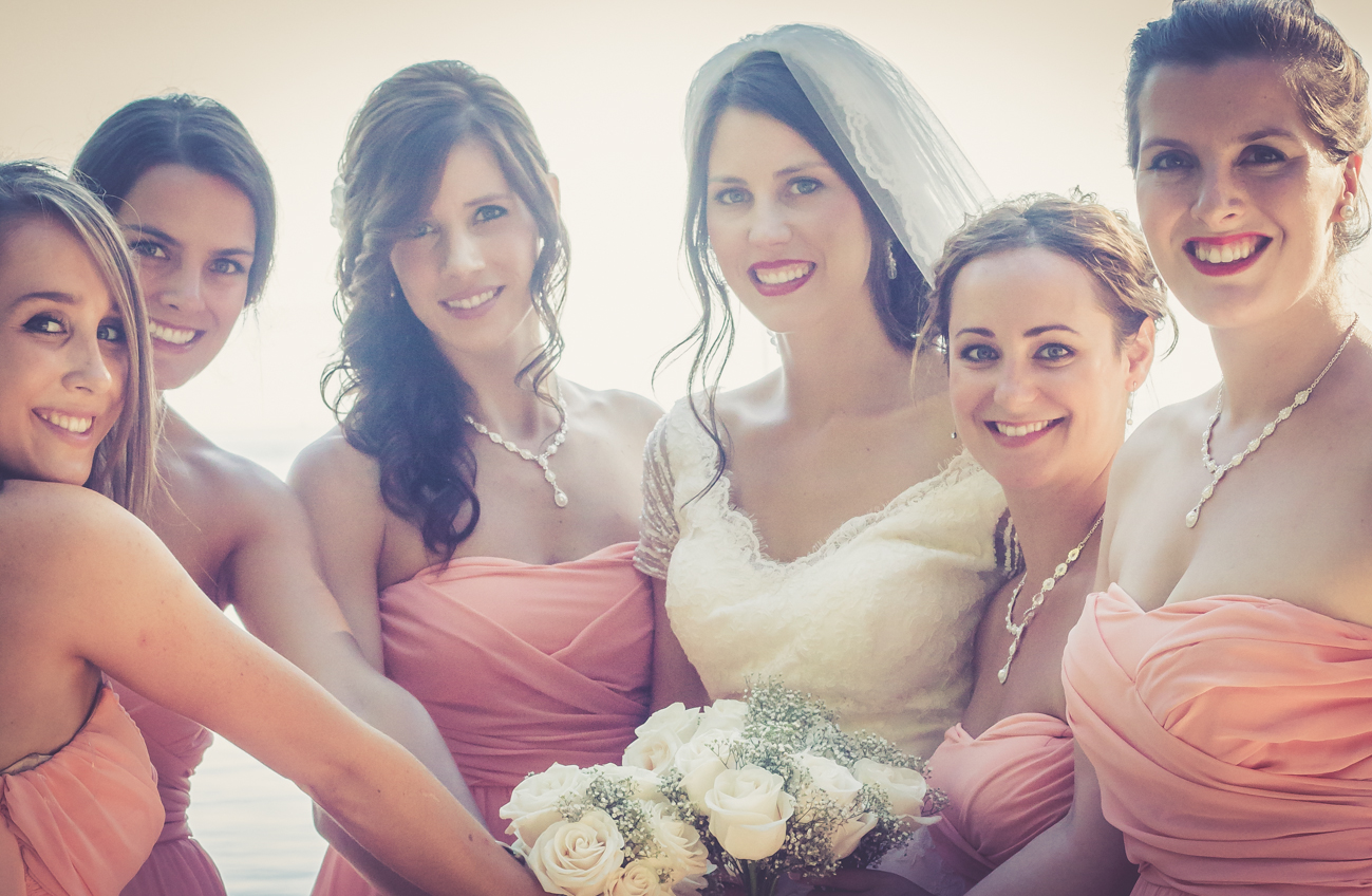 Bridesmaids holding bouquets around bride at Rockwater Secret cove elopement and wedding spot