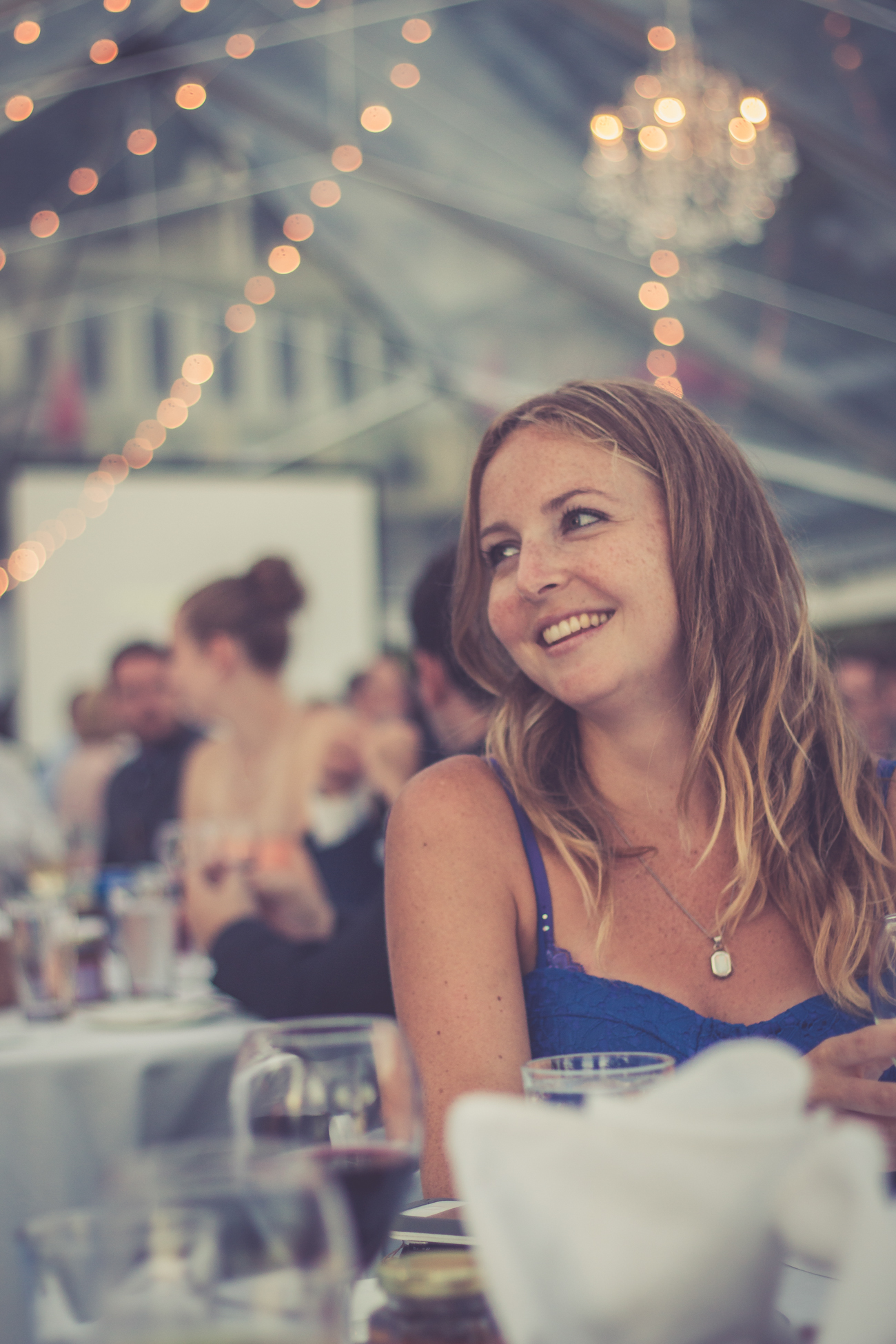 Guest laughing at table reception at Rockwater Secret cove elopement and wedding spot