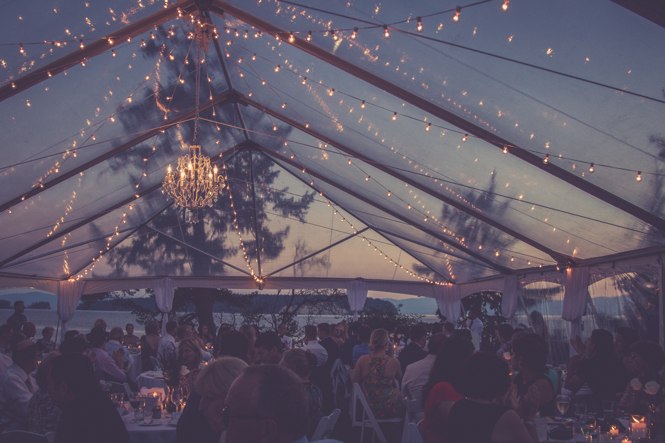 Open tent reception with fairy lights at Rockwater Secret cove elopement and wedding spot Tofino