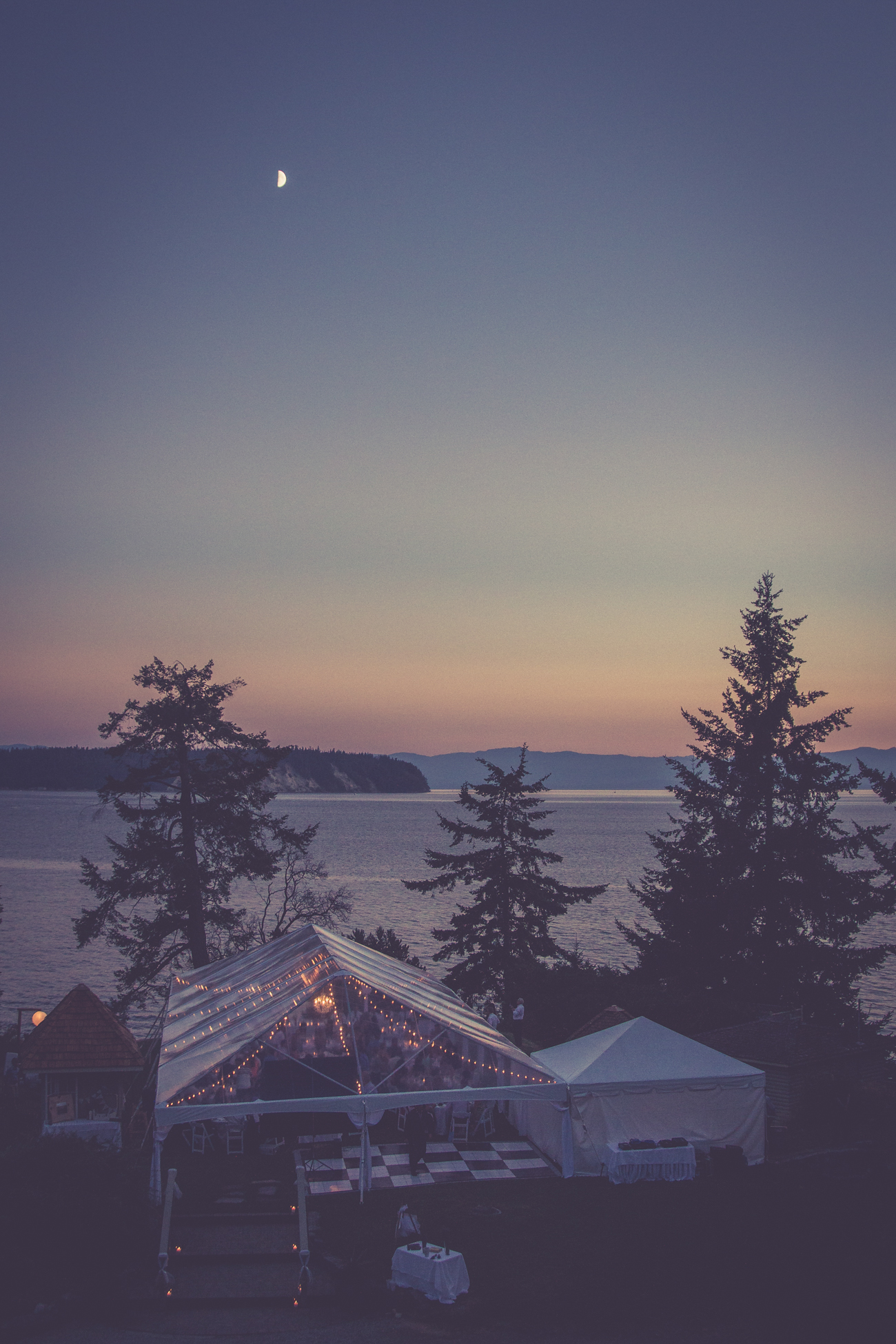 Tent reception overview with fairy lights at Rockwater Secret cove elopement and wedding spot Tofino