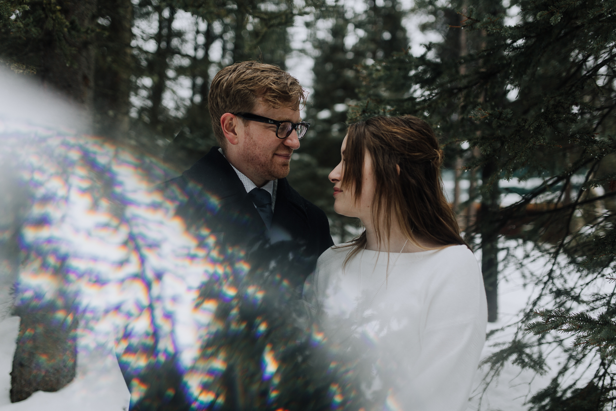 Prism photo of bride and groom married in snow during winter elopement at Storm Mountain Lodge