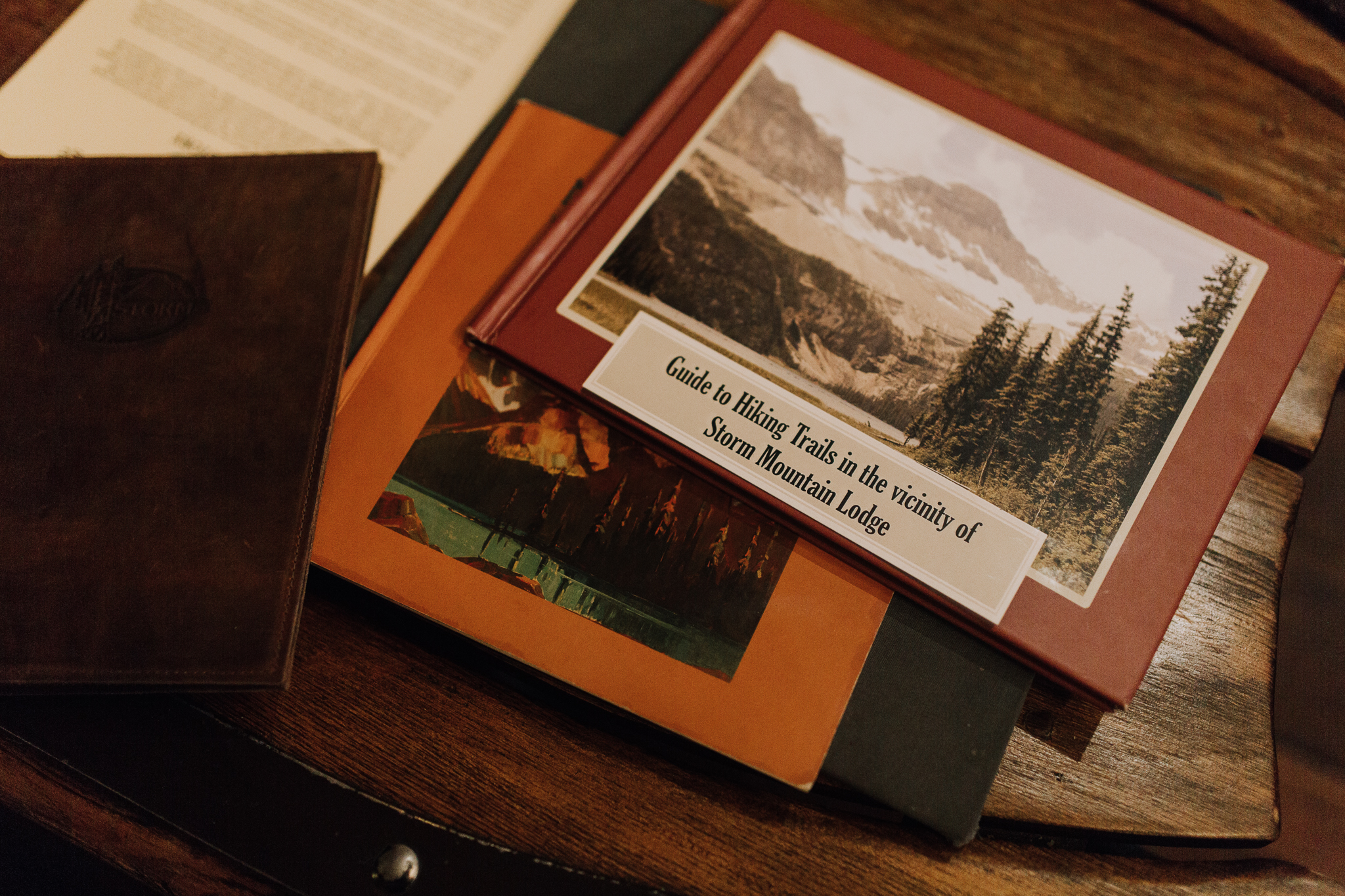 """Guide to Hiking Trails in the vicinity of Storm Mountain Lodge"" book on coffee table"