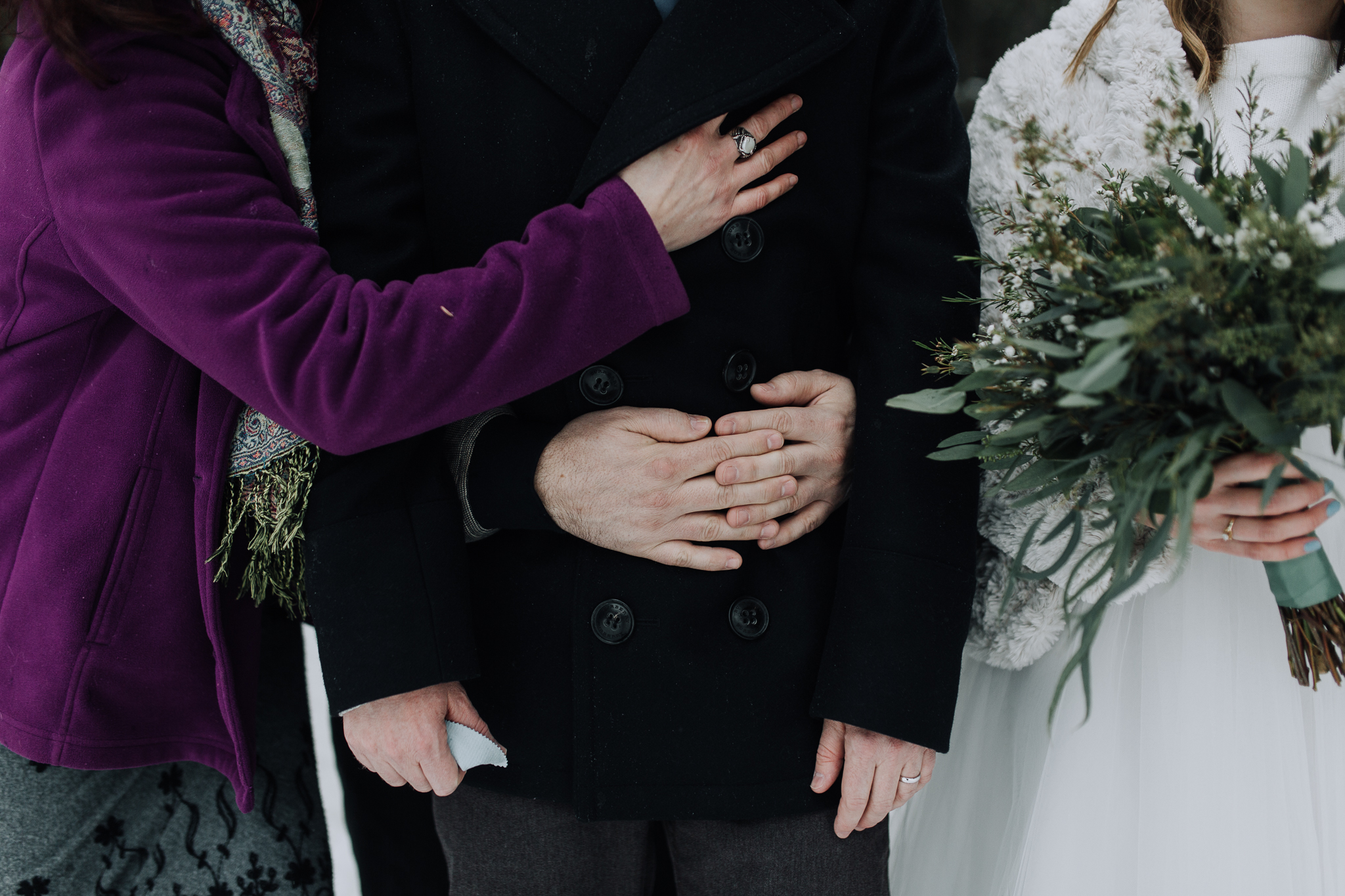 Guests hugging at Storm Mountain Lodge winter wedding