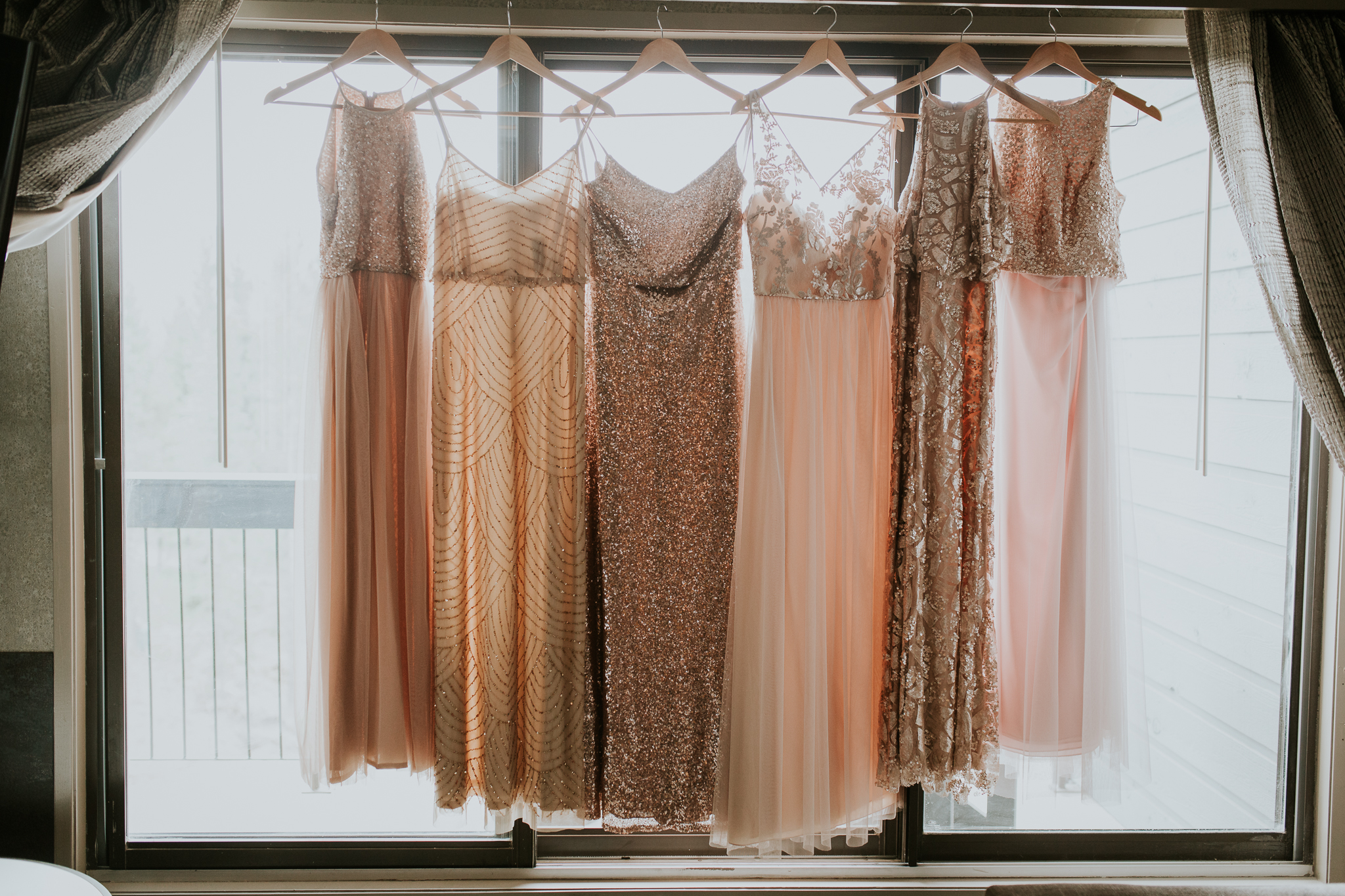 Bridesmaid gowns hanging in window of Delta Kananaskis